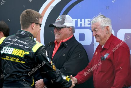 A.J. Foyt, Bobby Allison, Carl Edwards Carl Edwards, left, shakes hands with Bobby Allison, right, and A.J. Foyt, middle, as Allison and Foyt are honored as former drivers for Phoenix International Raceway 50th anniversary, prior to the NASCAR Sprint Cup Series auto race, in Avondale, Ariz