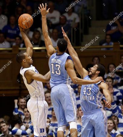 J.P. Tokoto, James Michael McAdoo, Rodney Hood Duke's Rodney Hood, left, shoots as North Carolina's J.P. Tokoto (13) and James Michael McAdoo (43) defend during the first half of an NCAA college basketball game in Durham, N.C