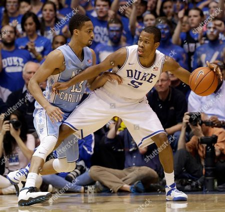 J.P. Tokoto, Rodney Hood Duke's Rodney Hood (5) is pressured by North Carolina's J.P. Tokoto (13) during the first half of an NCAA college basketball game in Durham, N.C