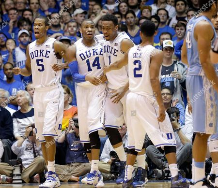 Rodney Hood, Rasheed Sulaimon, Jabari Parker, Quinn Cook Duke's Rodney Hood (5), Rasheed Sulaimon (14), Jabari Parker (1) and Quinn Cook huddle during the second half of an NCAA college basketball game against North Carolina in Durham, N.C., . Duke won 93-81
