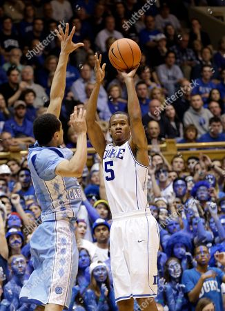 Marcus Paige, Rodney Hood Duke's Rodney Hood (5) shoots as North Carolina's Marcus Paige defends during the second half of an NCAA college basketball game in Durham, N.C., . Duke won 93-81