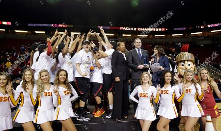 Cynthia Cooper Southern California's head coach Cynthia Cooper, center, stands with players after the team beat Oregon State to win the Pac-12 NCAA college championship basketball game, in Seattle. USC won 71-62