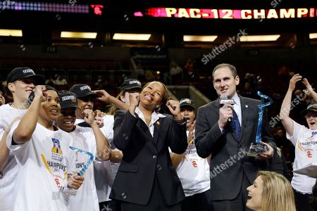 Cynthia Cooper, Larry Scott Southern California's head coach Cynthia Cooper, center, stands with players and Pac-12 commissioner Larry Scott after the team beat Oregon State to win the Pac-12 NCAA college championship basketball game, in Seattle. USC won 71-62