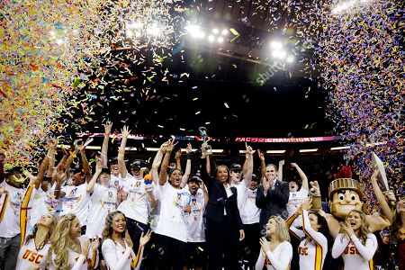 Cynthia Cooper Southern California's head coach Cynthia Cooper, center, and players celebrate after the team beat Oregon State to win the Pac-12 NCAA college championship basketball game, in Seattle. USC won 71-62
