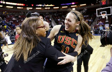 Cynthia Cooper, Cassie Harberts Southern California head coach Cynthia Cooper, left, embraces Cassie Harberts after the team beat Oregon State to win the Pac-12 NCAA college championship basketball game, in Seattle. USC won 71-62