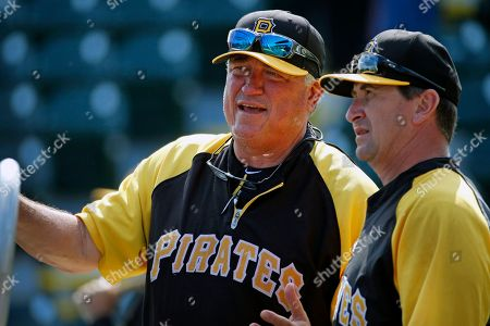 Jeff Branson, Clint Hurdle Pittsburgh Pirates manager Clint Hurdle, left, talks with hitting coach Jeff Branson during batting practice before the team's annual baseball spring training Black and Gold intra-squad game in Bradenton, Fla