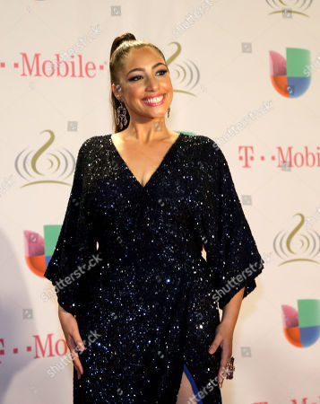 Leslie Cartaya Cuban singer Leslie Cartaya poses for photographers on the red carpet at the Premio Lo Nuestro Latin Music Awards in Miami