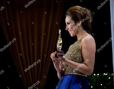 America Sierra America Sierra poses with her trophy during the Premio Lo Nuestro Latin Music Awards Show in Miami