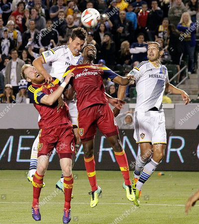 Stock Image of Nat Borchers, Aaron Maund, Bob Friend, Omar Gonzalez Real Salt Lake defenders Nat Borchers, left front, and Aaron Maund, collide with Los Angeles Galaxy forward Bob Friend, left rear, and defender Omar Gonzalez in the second half of an MLS soccer game in Carson, Calif., . Real Salt Lake won, 1-0