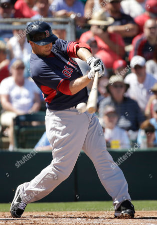 Stock Photo of Daniel Nava Boston Red Sox's Daniel Nava swings at a pitch by Minnesota Twins' Scott Diamond in the first inning of an exhibition baseball game, in Fort Myers, Fla