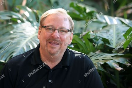 Rick Warren This photo Saddleback Church founder and senior pastor, Rick Warren poses for a photo at the Saddleback Church in Lake Forest, Calif. Warren will partner with the Roman Catholic Diocese of Orange and the National Alliance for Mental Illness next month for the first event of what they hope will be a sustained project to get faith leaders more involved with mental health issues and advocacy