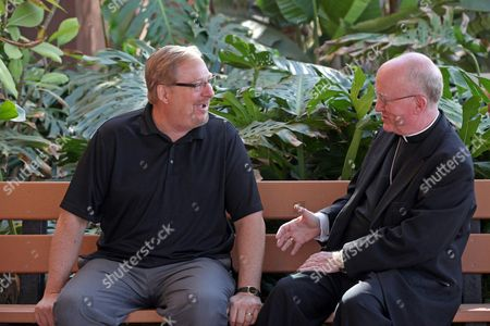 Rick Warren, Kevin William Vann This photo Saddleback Church founder and senior pastor, Rick Warren, left, and Bishop of the Roman Catholic Diocese of Orange, Kevin William Vann, right, pose for a photo at the Saddleback Church in Lake Forest, Calif. Warren will partner with the Roman Catholic Church and the National Alliance on Mental Illness next month for the first event of what they hope will be a sustained project to get faith leaders more involved with mental health issues and advocacy