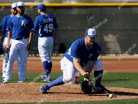 Brad Penny Kansas City Royals pitcher Brad Penny reaches down to field a ground ball as he and others participate in fielding drills during spring training baseball practice, in Surprise, Ariz