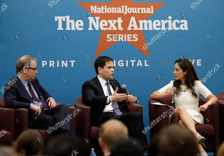 Stock Image of Marco Rubio, Ron Brownstein, Mariana Atencio Sen. Marco Rubio, center, responds to questions posed by Ron Brownstein, editorial director of Atlantic Media, left, and Mariana Atencio of Fusion, right, following a keynote address at an event held by The National Journal at Miami-Dade College about his plans to overhaul the country's higher education system, in Miami. Rubio is building on larger GOP effort to appeal to middle class voters who feel disaffected by the Republican Party