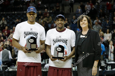 Bernadette McGlade, Langston Galloway, Ronald Roberts, Jr Atlantic 10 Commisioner Bernadette McGlade, right, poses for picture with Saint Joseph's Langston Galloway, center, and Ronald Roberts, Jr. and their All-Championship Team trophies after an NCAA college basketball game against VCU in the championship round of the Atlantic 10 Conference tournament at the Barclays Center in New York, . St. Joseph's defeated VCU 65-61