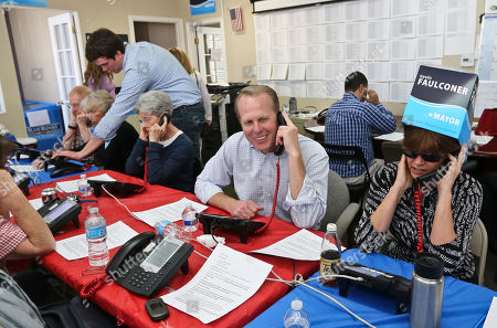 Kevin Faulconer San Diego mayoral candidate Kevin Faulconer sits among his volunteers calling voters, in San Diego. Faulconer faces fellow city commissioner David Alvarez in the race to replace disgraced mayor Bob Filner