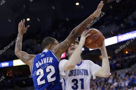 Brian Oliver, Will Artino Creighton's Will Artino (31) is guarded by Seton Hall's Brian Oliver (22) in the second half of an NCAA college basketball game in Omaha, Neb., . Creighton won 72-71