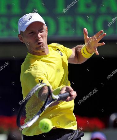 Nikolay Davydenko, Adrian Mannarino Nikolay Davydenko, of Russia, returns to Adrian Mannarino, of France, during the first round at the Sony Open tennis tournament at Key Biscayne, Fla
