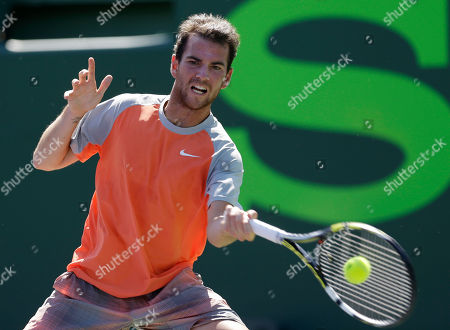 Adrian Mannarino Adrian Mannarino, of France, returns to Nikolay Davydenko, of Russia, during the first round at the Sony Open tennis tournament at Key Biscayne, Fla., . Mannarino won 6-4, 7-5