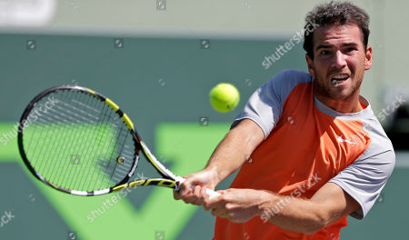 Adrian Mannarino, Nikolay Davydenko Adrian Mannarino, of France, returns to Nikolay Davydenko, of Russia, during the first round at the Sony Open tennis tournament at Key Biscayne, Fla