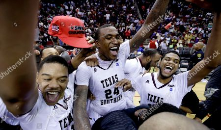 Aaric Murray, D'Angelo Scott, Lawrence Johnson-Danner Texas Southern players Lawrence Johnson-Danner, left, Aaric Murray (24) and D'Angelo Scott, right, celebrate after beating Prairie View A&M in an NCAA college basketball game in the championship of the Southwestern Athletic Conference tournament, in Houston. Texas Southern won 78-73