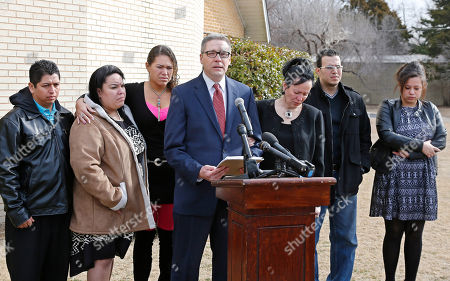 Juan Jantes, Yashira Jantes, Francheska Medina, Michael Brooks-Jimenez, Nair Rodriguez, Ryan Medina, Luinahi Rodriguez Members of the Rodriguez family are pictured with attorney Michael Brooks-Jimenez, fourth from left, during a news conference in Oklahoma City, . From left are Juan Jantes, Yashira Jantes, Francheska Medina, Michael Brooks-Jimenez, Nair Rodriguez, Ryan Medina and Luinahi Rodriguez. At the news conference, the family of Luis Rodriguez, a man who died after a struggle with police outside an Oklahoma movie theater, released a cellphone video of the incident that shows the man on his stomach on the ground with five officers restraining him, including one officer holding his head down