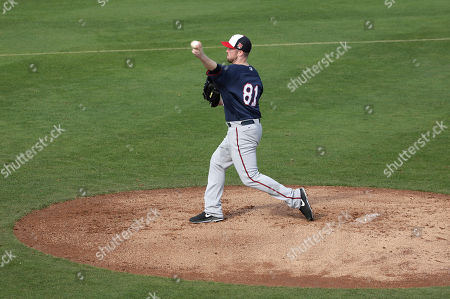 Stock Photo of Matt Hoffman Minnesota Twins relief pitcher Matt Hoffman winds up for a throw during spring training baseball practice, in Fort Myers, Fla