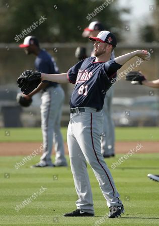 Matt Hoffman Minnesota Twins pitcher Matt Hoffman, center, winds up for a throw while warming up on the field during spring training baseball practice, in Fort Myers, Fla