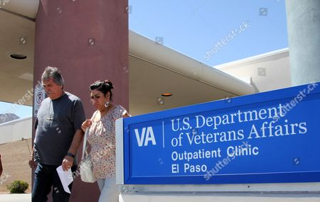 Stock Image of David and Marianne Trujillo exit the Vetarans Affairs facility in El Paso, Texas. In an analysis of six months of appointment data at 940 VA hospitals and clinics nationwide from September 2014 to February 2015, despite a nationwide push to lessen the wait times for veterans seeking health care, VA medical facilities across Texas have shown little to no sustained progress. The dilemma mirrors a trend across the country in which facilities are struggling to improve how often they meet the U.S. Department of Veterans Affairs' goal to have patients seen within 30 days