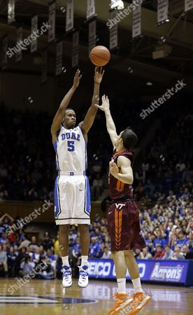 Rodney Hood, Devin Wilson Duke's Rodney Hood (5) shoots over Virginia Tech's Devin Wilson during the first half of an NCAA college basketball game in Durham, N.C., . Duke won 66-48