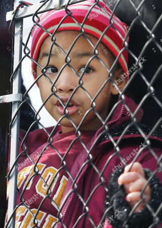 Lauren Anderson Lauren Anderson, 5, of Dallas, peers through the chain link fence to watch Boston College players warm up prior to playing Arizona in the AdvoCare V100 Bowl NCAA college football game, at Independence Stadium in Shreveport, La