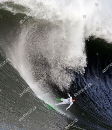 Nic Lamb AP10thingsToSee - Nic Lamb begins to fall off his board during the third heat of the first round of the Mavericks Invitational big wave surf contest in Half Moon Bay, Calif. on