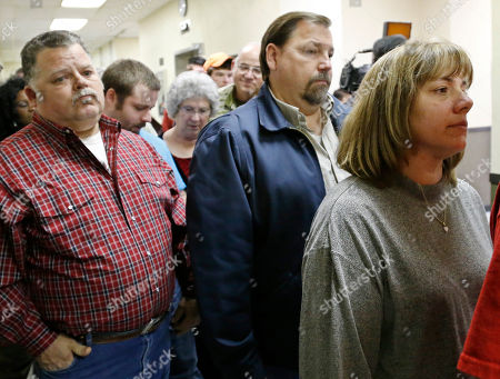 Sheryl Roberts, Gene Jones Sheryl Roberts, right, the mother of murder suspect Michael Jones, waits to enter the courtroom for a hearing in Duncan, Okla, . At left is Gene Jones, the father of Michael Jones. The three teenagers accused of fatally shooting Australian Christopher Lane as he jogged down a street in Duncan, Oklahoma, allegedly because they were bored, are expected in court for a hearing that could reveal details about the case. First-degree murder charges have been filed against 18-year-old Michael Dewayne Jones and two 16-year-olds, Chancey Allen Luna and James Francis Edwards Jr