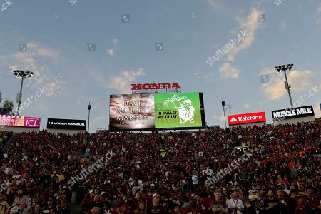A tribute to Associated Press photographer Dave Martin on the scoreboard at the Rose Bowl before the NCAA BCS National Championship college football game between Auburn and Florida State, in Pasadena, Calif
