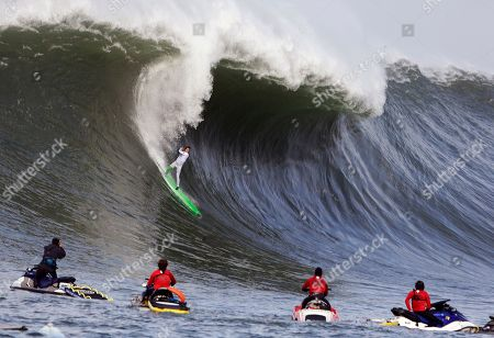 Nic Lamb Nic Lamb rides a wave during the third heat of the first round of the Mavericks Invitational big wave surf contest, in Half Moon Bay, Calif