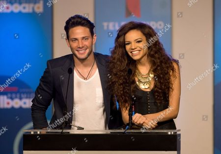 Gabriel Coronel, Leslie Grace Venezuelan actor Gabriel Coronel, left, and Dominican singer Leslie Grace announce finalists, in Miami during a news conference for the Billboard Latin Music Awards. The awards will air live on the Telemundo network April 24. Grace is a finalist in two categories