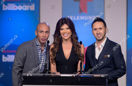 Mirella Grisales, Alexis & Fido Colombian actress, model and Telemundo sports reporter Mirella Grisales, center, and Puerto Rican reggaeton duo Alexis & Fido announce finalists, in Miami during a news conference for the Billboard Latin Music Awards. The awards will air live on the Telemundo network April 24. Alexis & Fido are finalists in four categories