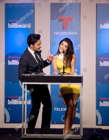 Shalim, Daniela Navarro Puerto Rican singer Shalim and Venezuelan actress Daniela Navarro joke on stage, in Miami during a news conference to announce the finalists for the Billboard Latin Music Awards. The awards will air live on the Telemundo network April 24