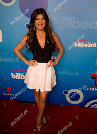Stock Image of Mirella Grisales Colombian actress, model and Telemundo sports reporter Mirella Grisales poses on the red carpet after a news conference announcing the finalists for the Billboard Latin Music Awards, in Miami. The awards will air live on the Telemundo network April 24