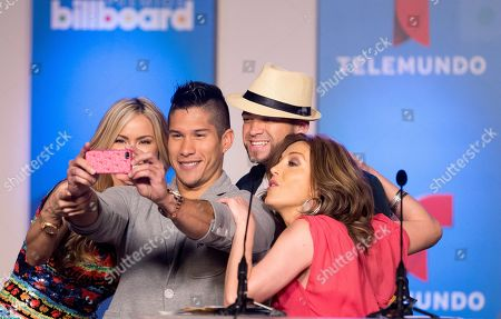 Stock Photo of Aylin Mujica, Laura Flores, Chino & Nacho Hosts Aylin Mujica, left, and Laura Flores, right, take a selfie with Venezuelan reggaeton duo Chino & Nacho, in Miami during a news conference announcing the finalists for the Billboard Latin Music Awards. The awards will air live on the Telemundo network April 24
