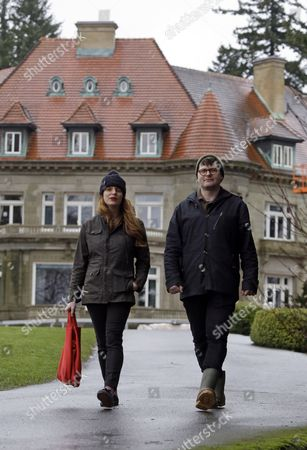 """Colin Meloy, Carson Ellis This photo shows Colin Meloy, right, front man and songwriter for the indie folk band, The Decemberists, and his illustrator wife, Carson Ellis, walk in front of Pittock Mansion in the west hills of Portland, Ore. The couple have just published the third installment of a popular adventure book series for middle-schoolers called the """"Wildwood Chronicles."""" The third volume is titled """"Wildwood Imperium"""