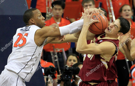 Danny Rubin, Akil Mitchell Boston College guard Danny Rubin (31) grabs a rebound in front of Virginia forward Akil Mitchell (25) during the second half of an NCAA college basketball game in Charlottesville, Va., . Virginia won the game 77-67