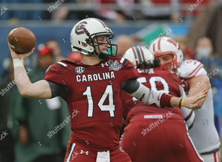 Connor Shaw, Pat Muldoon South Carolina quarterback Connor Shaw (14) throws a pass as he is rushed by Wisconsin defensive end Pat Muldoon, right, during the first half of the Capital One Bowl NCAA college football game in Orlando, Fla