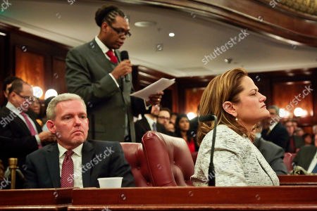 Councilmember Melissa Mark-Viverito, right, listens as Councilman Robert Cornegy, center, endorses her as the new City Council Speaker on in New York. The 51-member body voted unanimously on Wednesday, for Mark-Viverito, who becomes the first Hispanic person to hold the speaker's job. Councilman Jimmy Van Bramer listens at let