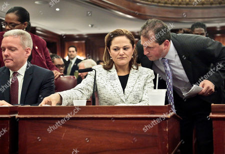 City Council Speaker Melissa Mark-Viverito, center, listens as Councilman Brad Lander, right, speaks to her on in New York. The 51-member body voted unanimously on Wednesday for Mark-Viverito, who becomes the first Hispanic person to hold the speaker's job. At left is councilman Jimmy Van Bramer