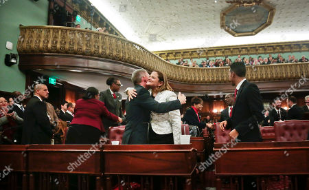 Councilman Jimmy Van Bramer, left center, embraces new City Council Speaker Melissa Mark-Viverito on in New York. The 51-member body voted unanimously for Mark-Viverito, who becomes the first Hispanic person to hold the speaker's job