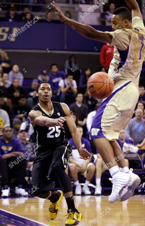 Spencer Dinwiddie, Darin Johnson Colorado's Spencer Dinwiddie (25) puts a baseline pass by Washington's Darin Johnson in the first half of an NCAA men's basketball game, in Seattle