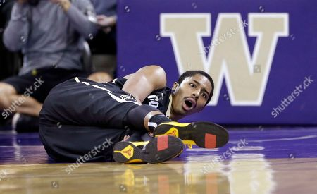 Stock Image of Spencer Dinwiddie Colorado's Spencer Dinwiddie looks up after falling to the court against Washington with an injury in the first half of an NCAA college basketball game, in Seattle