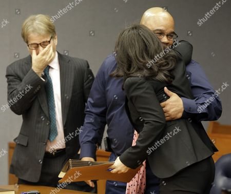 Gerard Richardson, Vanessa Potkin, Barry Scheck Gerard Richardson, center, who was incarcerated for 19 years, gets a hug from Vanessa Potkin, right, senior attorney at the Innocence Project, as attorney Barry Scheck reacts moments after Richardson was exonerated, in Somerville, N.J. A Somerset County prosecutor told judge Julie Marino that his office wants to dismiss the indictment against Richardson, who was convicted in 1995 largely on bite-mark evidence taken from the 19-year-old Monica Reyes' back. Attorneys from the Innocence Project challenged the bite-mark evidence, and it was eventually determined the bite mark contained another man's DNA