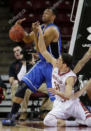 Danny Rubin, Jabari Parker Boston College guard Danny Rubin (31) knocks the ball away from Duke forward Jabari Parker (1) during the second half of their NCAA college basketball game on the Boston College campus in Boston, . Duke defeated Boston College 89-68